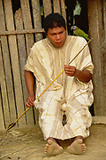 Machiguenga Indian making Arrow for fishing<br />