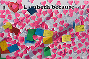 """I love Lambeth because .."" post-it notes express an affection for south Londoners' home borough, left on a country show noticeboard. Pink heart-shaped stickers tell the viewer how much they appreciate life in this inner-city region of the capital where crime is a major negative aspect of living here. Many reasons are written by children whose optimism seems untainted."