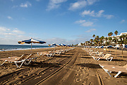 Empty sun beds line up on the deserted beach in Playa Matagorda, Lanzarote, Spain on 22nd November 2020. Beaches and resorts across the island are nearly deserted since tourism plummeted due to Covid restrictions elsewhere in Europe. Although the Canary Islands have been relatively unscathed by the virus, with 155 lives lost from 2.1 million residents, the region is heavily dependent on tourism and locals are hoping that numbers recover as lockdown measures ease and vaccines potentially reduce the numbers of infections.