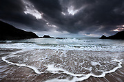 Waves on an incoming tide in bad weather at Porth Iago on the Llyn Peninsula, North West Wales.
