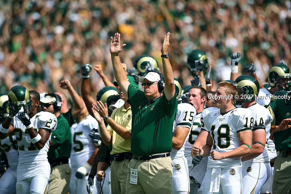 SHOT 9/1/2007 - Colorado State coaches and bench players react to an early touchdown by Kory Sperry (TE, not pictured) during the first half of the Rocky Mountain Showdown Saturday September 1, 2007 at Invesco Field in Denver, Co. The University of Colorado won the Centennial Cup with a 31-28 overtime victory in the game. Colorado and Colorado State have met 78 times in their histories, but the first 69 took place on their respective campuses. The Colorado Buffaloes are in the Big 12 Conference, while the Colorado State Rams compete in the Mountain West Conference..(Photo by Marc Piscotty © 2007)