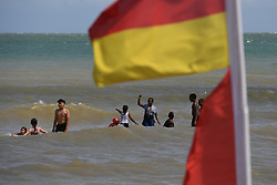 Holiday makers enjoy the warm weather on Broadstairs Beach in Kent.