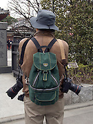 a photographer seen from behind