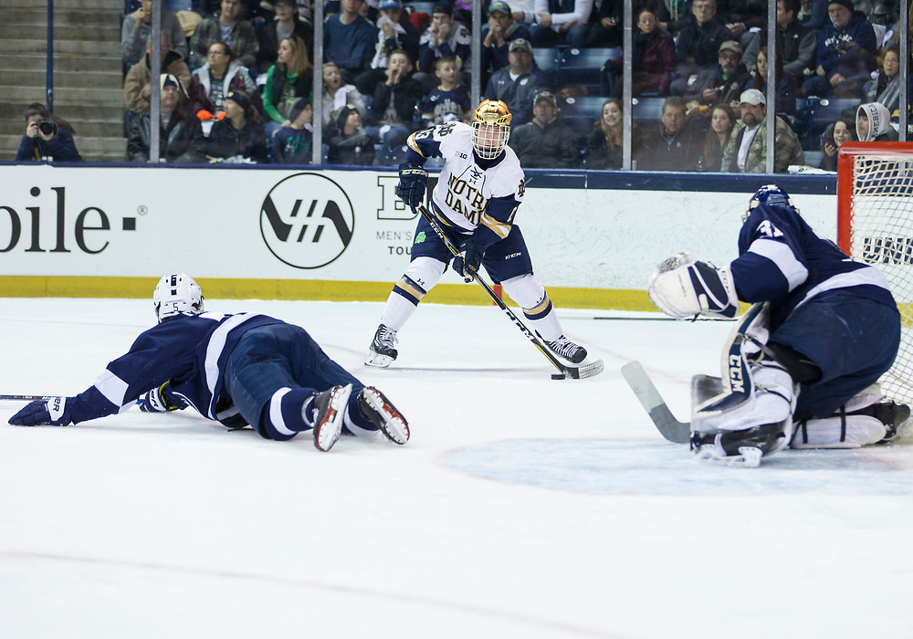 March 10, 2018:  Notre Dame forward Colin Theisen (13) controls the puck as Penn State defenseman Kevin Kerr (5) defends during NCAA Hockey game action between the Notre Dame Fighting Irish and the Penn State Nittany Lions at Compton Family Ice Arena in South Bend, Indiana.  Notre Dame defeated Penn State 3-2.  John Mersits/CSM