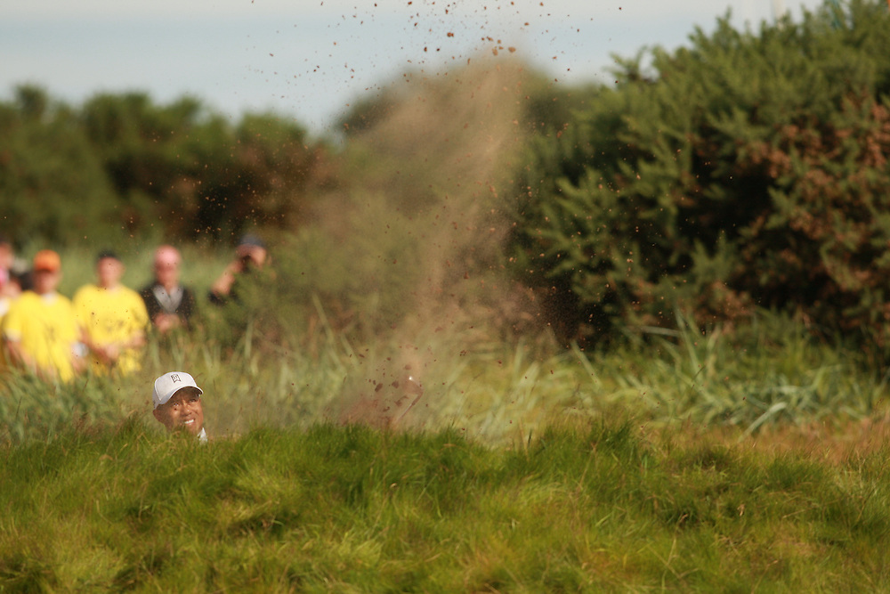 CARNOUSTIE, SCOTLAND - JULY 20: Tiger Woods hits a bunker shot during the second round of the 136th Open Championship in Carnoustie, Scotland at Carnoustie Golf Links on Friday, July 20, 2007. (Photo by Darren Carroll/Getty Images) *** LOCAL CAPTION *** Tiger Woods