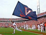 Sept. 3, 2011 - Charlottesville, Virginia - USA; Virginia Cavaliers cheerleaders run with the school flag during an NCAA football game against William & Mary at Scott Stadium. Virginia won 40-3. (Credit Image: © Andrew Shurtleff
