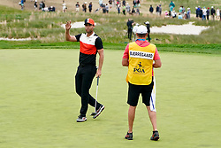 May 19, 2019 - Bethpage, New York, United States - Lucas Bjerregaard (L) waves to the gallery after putting the 18th green during the final round of the 101st PGA Championship at Bethpage Black. (Credit Image: © Debby Wong/ZUMA Wire)