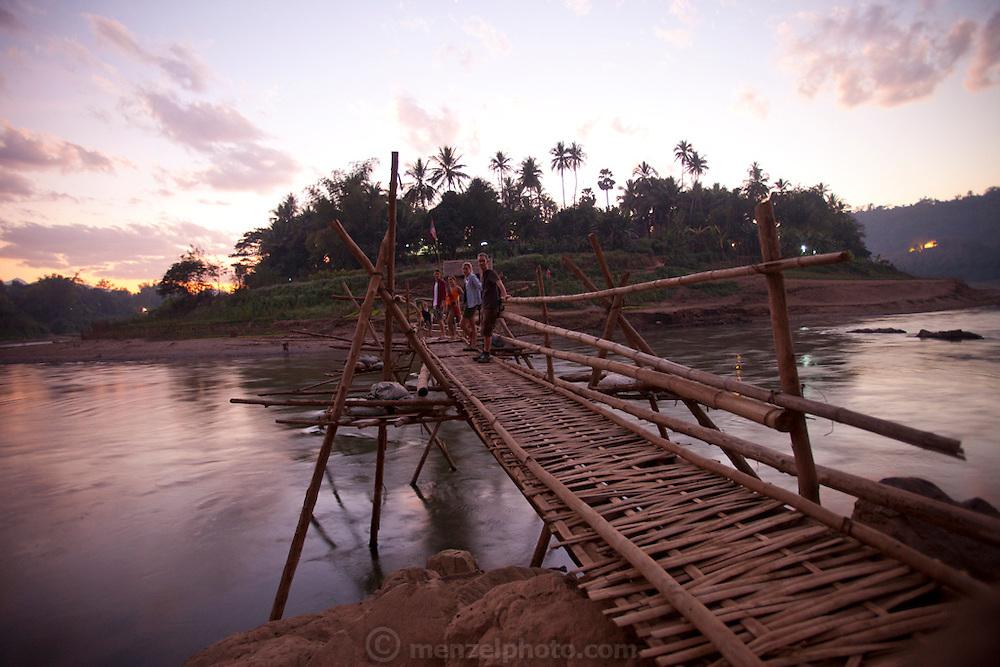 Bamboo bridge across the Nam Khan River, Luang Prabang, Laos.