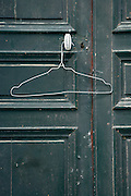 old door handle with a wire clothes hanger