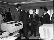 Taoiseach At Kelly's Bakery Kilcock..1986..08.09.1986..09.08.1986..8th September 1986..Today the Taoiseach,Garret Fitzgerald,officially opened a new computer centre at Kelly's Bakery. The bakery is a large employer based in Kilcock,Co Kildare. Mr Fitzgerald was accompanied by the Minister for Justice,Mr Alan Dukes and Mr Bernard Durkan TD...Photo shows Mr Pat Smyth,General Manager,Kelly's explaining the computer system to Mr Alan Dukes,Minister for Justice,Taoiseach,Garret Fitzgerald and Mr Bernard Durkan TD.