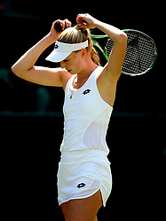 Naomi Broady adjusts her bobble during her match against Garbine Muguruza on day two of the Wimbledon Championships at the All England Lawn Tennis and Croquet Club, Wimbledon.