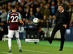 West Ham United manager Slaven Bilic (right) kicks the ball to West Ham United's Sam Byram during the Carabao Cup, third round match at the London Stadium.