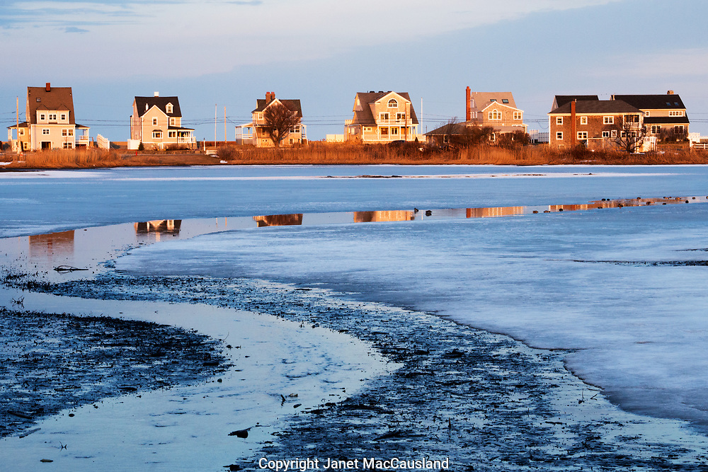 A necklace of beach houses reflect in the salt creek of Scituate, Massachusetts, south of Boston, Massachusetts.