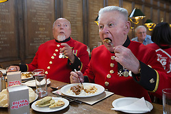 © licensed to London News Pictures. London, UK 02/10/2012. Chelsea Pensioners eating curry meal as they launc The Soldiers' Charity Big Curry season with a special curry lunch at Royal Hospital Chelsea's Royal Hall in London on 02/10/12. (Names: (left to right) Wayne Campbell, David Donaghey) Photo credit: Tolga Akmen/LNP