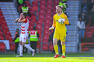 Lee Burge of Coventry City (1) with the ball as John Marquis of Doncaster Rovers (9) reacts in the background during the EFL Sky Bet League 1 match between Doncaster Rovers and Coventry City at the Keepmoat Stadium, Doncaster, England on 4 May 2019.