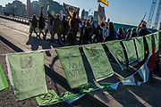 Protestors from Southwark Bridge join protestors on Blackfriars Bridge which is still blocked - Extinction Rebellion Day -  co hosted by Rising Up, 'Rebel Against the British Government For Criminal Inaction in the Face of Climate Change Catastrophe and Ecological Collapse'. A protest that involves blocking 5 bridges: Southwark, Blackfriars, Waterloo, Westminster and Lambeth.