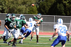 17 September 2011: Rob Gallik passes to T.J. Stinde during an NCAA Division 3 football game between the Aurora Spartans and the Illinois Wesleyan Titans on Wilder Field inside Tucci Stadium in.Bloomington Illinois.