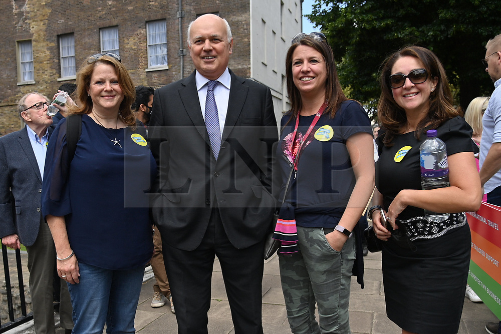 © Licensed to London News Pictures. 23/06/2021. London, UK. IAN DUNCAN SMITH  MP joins protesters representing the UK travel industry take part in a demonstration in Westminster highlighting the situation the current border and travel restrictions due to the Covid 19 pandemic. Industry estimates show more than a third (37 per cent) of the UK's 526,000 travel and tourism jobs could be wiped out due to the pandemic. Photo credit: Ray Tang/LNP