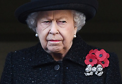 The Queen appears to shed a tear whilst attending the National Service of Remembrance at the Cenotaph, Whitehall, London. Photo credit should read: Doug Peters/EMPICS