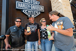 Gina and David Torres of Denver had bottles of spirits signed by Jesse James Dupree, lead vocalist of Jackyl (and part of the Full Throttle Saloon and Jesse James Bourbon) and Michael Ballard of the Full Throttle Saloon at the Harley-Davidson Rally Point on the corner of Main and Harley-Davidson Way during the Sturgis Black Hills Motorcycle Rally. SD, USA. Saturday, August 10, 2019. Photography ©2019 Michael Lichter.