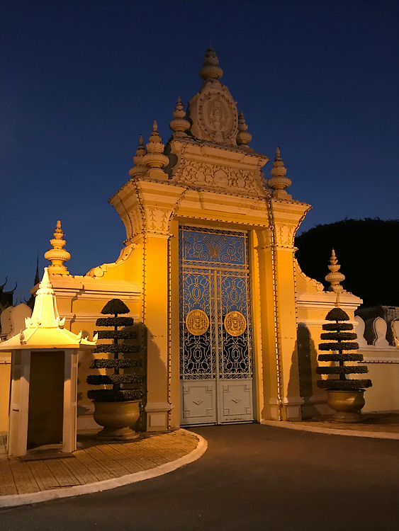 Royal Palace complex side entrance at night, Phnom Penh, Cambodia<br /> The Royal Palace is a complex of buildings which serves as the royal residence of the king of Cambodia.