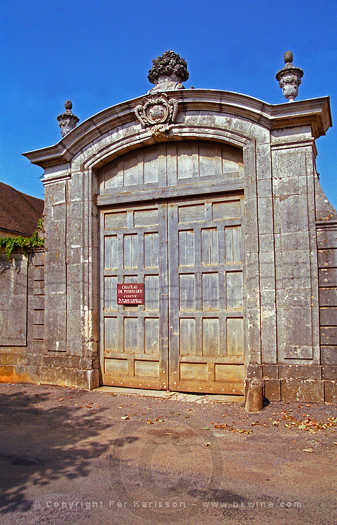 The entrance to Chateau de Pommard: an enormous, old wooden door and stone portico