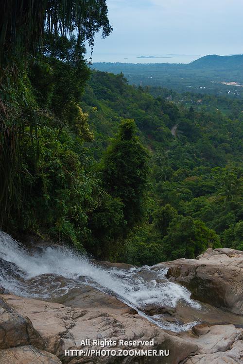 Panorama of upper Namuang waterfall, water running down the rocks, Samui, Thailand