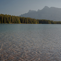 Mount Rundle rises behind  Two Jack Lake in Banff National Park, Alberta, Canada.