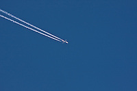Contrails are a narrow line of ice-crystal clouds formed by flying airplanes.
