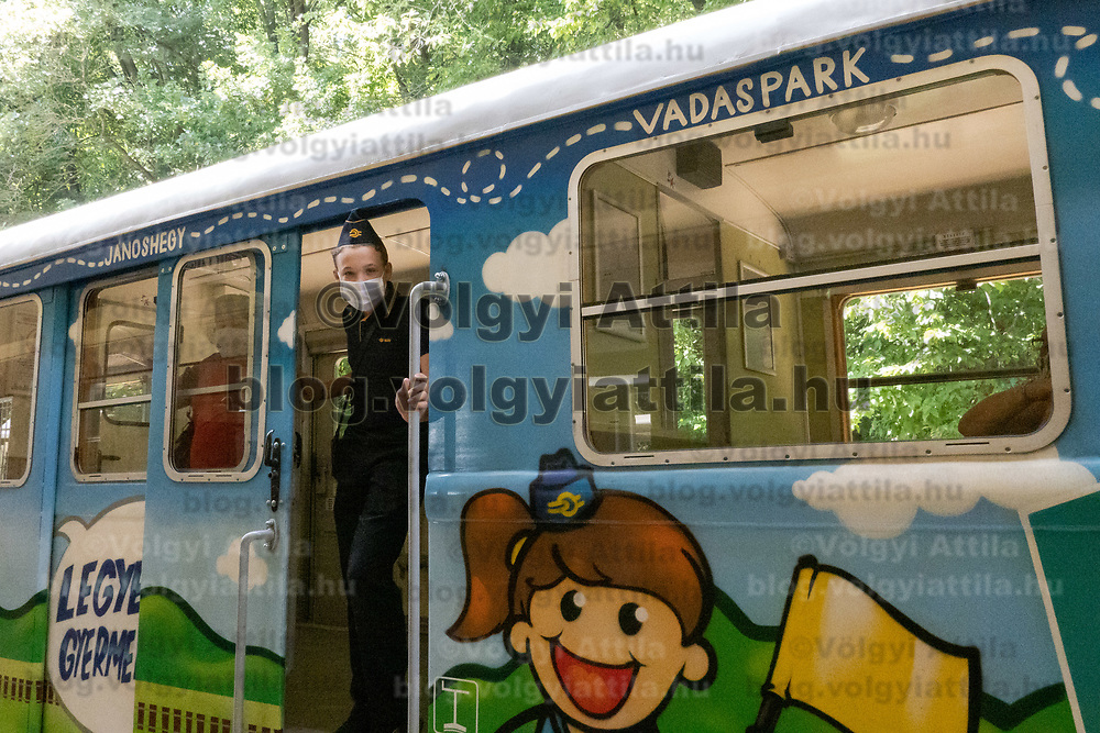 Child works on a train at the Children's Railway in Budapest, Hungary on Aug. 26, 2020. ATTILA VOLGYI
