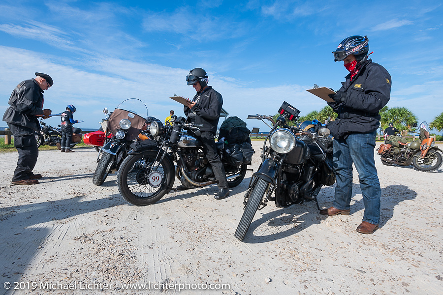 Todd Cameron (R) and Larry Luce (Center) fill out a pop quiz at a checkpoint on the Cross Country Chase motorcycle endurance run from Sault Sainte Marie, MI to Key West, FL. (for vintage bikes from 1930-1948). 287 mile ride of Stage-8 from Tallahassee to Lakeland, FL USA. Friday, September 13, 2019. Photography ©2019 Michael Lichter.