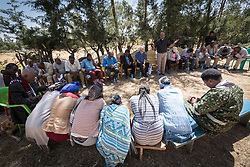31 January 2019, Southern Nations, Nationalities, and Peoples' Region, Ethiopia: EECMY president Rev. Yonas Dibisa leads a word of prayer together with members of the Tesfa ('hope') self-help group for women, which undertakes community banking to raise women's economic status and independence. Through the Mekane Yesus Food Security Project for Lemo Community, the Ethiopian Evangelical Church Mekane Yesus' development wing Development and Social Services Commission helps women raise their socio-economic status through community banking efforts and education, and helps improve communities' food security through training in agricultural methods suitable in a changing climate.