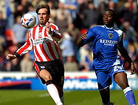 Photo: Alan Crowhurst.<br />Southampton v Cardiff City. Coca Cola Championship. 01/04/2006. Saints Claus Lundekvam (L) challenges with Guylain Ndumbu-Nsungu.