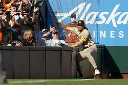 San Diego Padres left fielder Jake Marisnick (16) cannot make the catch of a foul popup by San Francisco Giants' Brandon Crawford during the ninth inning of a baseball game, Saturday, Oct. 2, 2021, in San Francisco. (AP Photo/D. Ross Cameron)