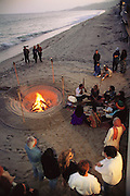Southern California Coast: Malibu beach party at the home of Andrea Ross; with native Indian ceremony. Pacific Ocean.