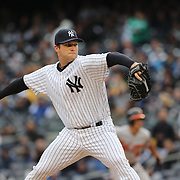 Adam Warren, New York Yankees, pitching during the New York Yankees V Baltimore Orioles home opening day at Yankee Stadium, The Bronx, New York. 7th April 2014. Photo Tim Clayton