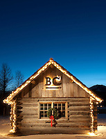 A snow covered log cabin at Bar BC Ranch is decorated for christmas in Jackson Hole, Wyoming.