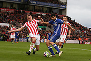 Diego Costa of Chelsea has a shot blocked by Ryan Shawcross of Stoke city (l). Premier league match, Stoke City v Chelsea at the Bet365 Stadium in Stoke on Trent, Staffs on Saturday 18th March 2017.<br /> pic by Andrew Orchard, Andrew Orchard sports photography.