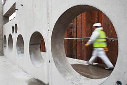 Heathrow, new T2A development, construction worker seen through concrete template, 22 October 2010.