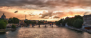 A high dynamic range photo of the sun setting over the Seine River in Paris, France on May 20, 2012.