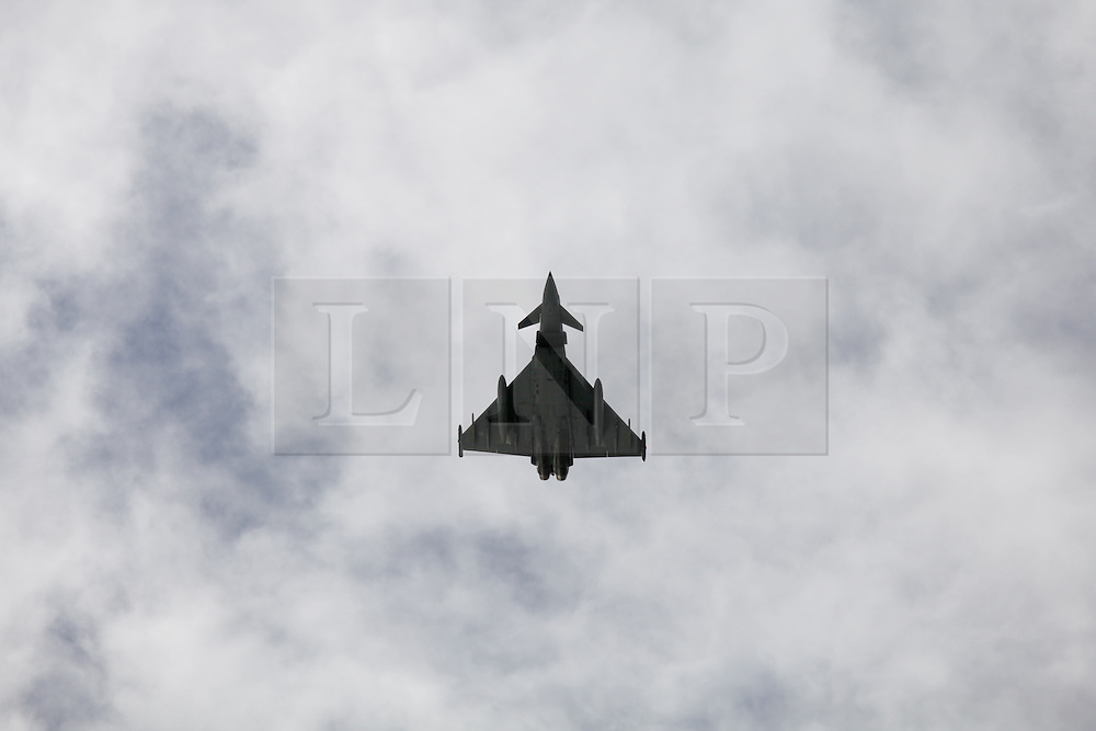 © Licensed to London News Pictures. 28/02/2014. Portsmouth, UK. An RAF Eurofighter Typhoon performs a fly past. The Royal Navy  Type 45 destroyer, HMS Daring arrives back in  her home port of Portsmouth today, 28th February 2014, following a 9 month trip. The trip included being diverted to help people in the Philippines following the devastation caused by Typhoon Haiyan. Photo credit : Rob Arnold/LNP