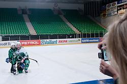 Katja Jan taking picture of Ivo Jan with son Lan Matija Jan during ice-hockey match between HK Olimpija and HK Triglav in third match for Third place at Slovenian National League, on April 6, 2011 at Hala Tivoli, Ljubljana, Slovenia. (Photo By Matic Klansek Velej / Sportida.com)