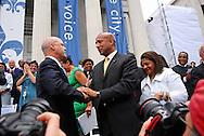 Photograph of former New Orleans Mayor C. Ray Nagin congratulates incoming Mayor Mitch Landrieu at his inauguration on May 3, 2010.