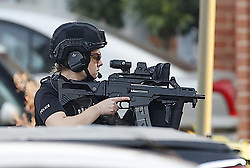 © Licensed to London News Pictures. 27/03/2020. Great Bookham, UK. Armed police surround a residential property in Great Bookham, Surrey. Emergency services and a police helicopter have been at the scene since around 4pm this afternoon. Photo credit: Peter Macdiarmid/LNP