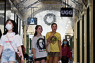 Girls are seen in one of Melbournes many malls which have now reopened during Black Friday sales in the CBD.  As temperatures soured in Melbourne, locals flock to the city for Christmas bargains. Victoria saw its 29th day of no cases today but despite this the government show no signs of further lifting of restrictions. (Photo by Dave Hewison/Speed Media)