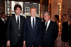 BERNARD ARNAUD the founder, chairman, and CEO of LVMH, his son ANTOINE ARNAUD and YVES CARCELLE at a party to celebrate the opening of the Louis Vuitton Bond Street Maison, New Bond Street, London on 25th May 2010.