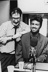 File photo dated 31/08/90 of George Michael (right) with BBC Radio 1 DJ Steve Wright. Pop superstar Mr Michael has died peacefully at home, his publicist said.