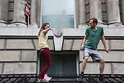 A couple dancing in Whitehall. The anti-austerity march, the People's Assembly saw tens of thousands marching and protestin in the streets of London against the newly elected conservative government.