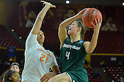 March 18, 2016; Tempe, Ariz;  Green Bay Phoenix guard Kaili Lukan (4) goes up for a shot against Tennessee Lady Volunteers center Mercedes Russell (21) during a game between No. 7 Tennessee Lady Volunteers and No. 10 Green Bay Phoenix in the first round of the 2016 NCAA Division I Women's Basketball Championship in Tempe, Ariz.