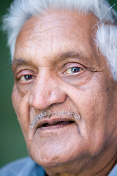 Portrait of an older man looking thoughtful,